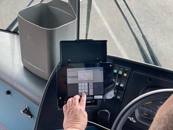 Driver enters pin code at front of bus.